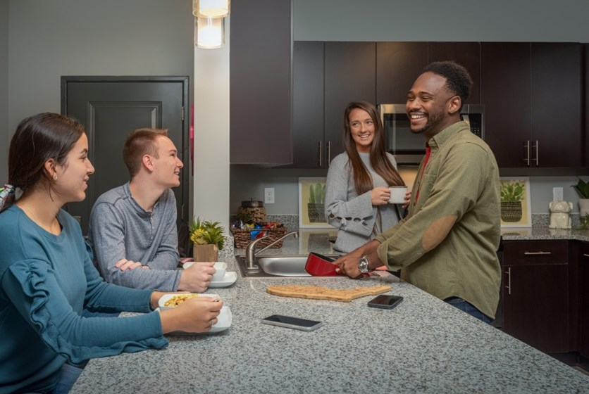 Friends spending time together at their Off Campus Apartment